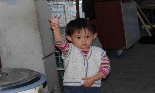 Zdjecie CHINY / Shanghai / Przedmieście / wiara w naród