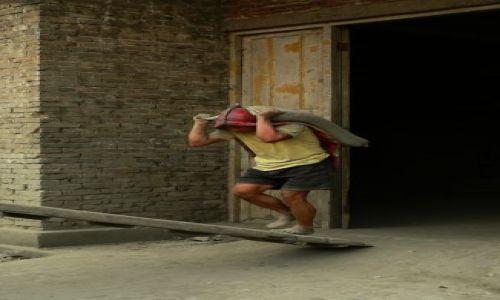 Zdjecie CHINY / Guangxi / Daxa / na buty jeszcze nie zarobił