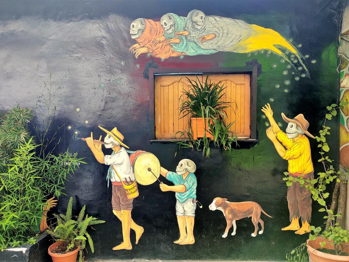 Zdjęcia: Jezioro Atitlán, Murale na ścianie, GWATEMALA