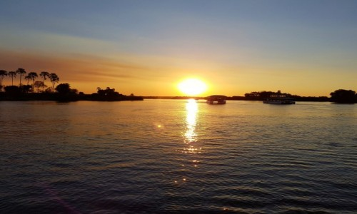 Zdjęcie ZIMBABWE / Pół.  zachodnie Zimbabwe / Rzeka Zambezi / Zachód słońca na Zambezi